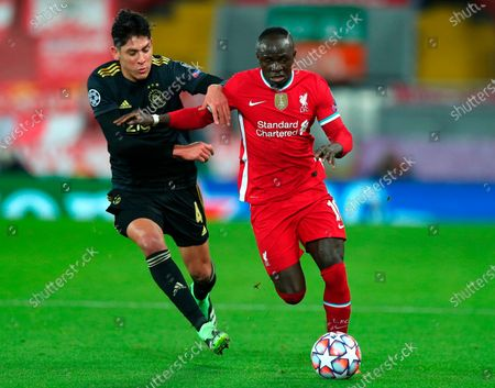 Liverpool's Sadio Mane (R) in action against Edson Alvarez (L) of Ajax during the UEFA Champions League group D soccer match between Liverpool FC and Ajax Amsterdam in Liverpool, Britain, 01 December 2020.