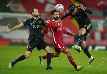 Mohamed Salah (C) of Liverpool in action against Daley Blind (L) and Edson Alvarez of Ajax during the UEFA Champions League group D soccer match between Liverpool FC and Ajax Amsterdam in Liverpool, Britain, 01 December 2020.