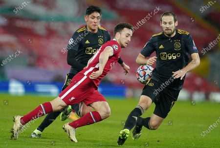 Diogo Jota (C) of Liverpool in action against Daley Blind (R) and Edson Alvarez of Ajax during the UEFA Champions League group D soccer match between Liverpool FC and Ajax Amsterdam in Liverpool, Britain, 01 December 2020.
