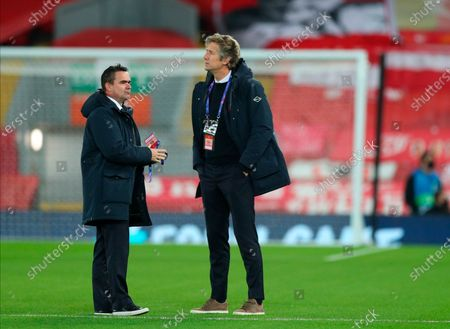 Ajax Amsterdam's director of football Marc Overmars (L) and Ajax CEO Edwin van der Sar (R) inspect the pitch ahead of the UEFA Champions League group D soccer match between Liverpool FC and Ajax Amsterdam in Liverpool, Britain, 01 December 2020.