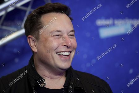Stock Image of SpaceX owner and Tesla CEO Elon Musk arrives on the red carpet for the Axel Springer media award, in Berlin, Germany