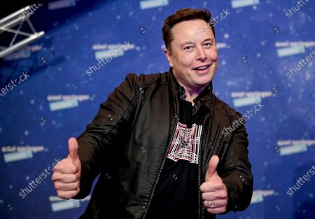 SpaceX owner and Tesla CEO Elon Musk arrives on the red carpet for the Axel Springer media award, in Berlin, Germany