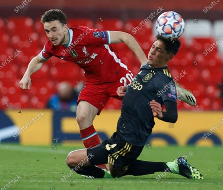 Stock Picture of Liverpool's Diogo Jota, left, and Ajax's Edson Alvarez vie for the ball during the Champions League group D soccer match between Liverpool and Ajax at Anfield stadium in Liverpool, England
