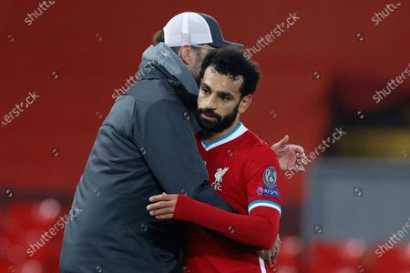 Liverpool's manager Jurgen Klopp hugs Liverpool's Mohamed Salah as he leaves the pitch to be substituted during the Champions League group D soccer match between Liverpool and Ajax at Anfield stadium in Liverpool, England