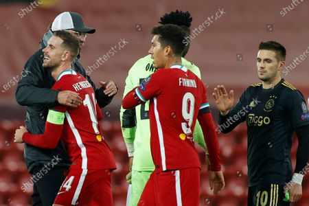 Liverpool's manager Jurgen Klopp hugs Liverpool's Jordan Henderson after the Champions League group D soccer match between Liverpool and Ajax at Anfield stadium in Liverpool, England