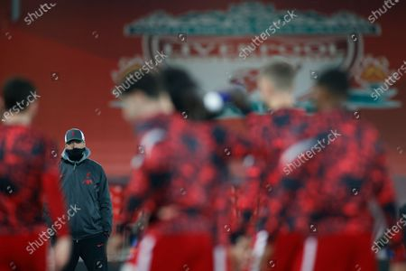 Liverpool's manager Jurgen Klopp, rear left, watches his team during the warmup prior to the Champions League group D soccer match between Liverpool and Ajax at Anfield stadium in Liverpool, England