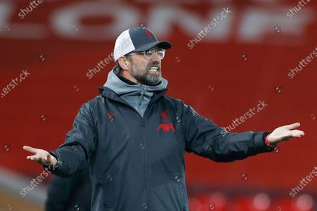 Liverpool's manager Jurgen Klopp gestures during the Champions League group D soccer match between Liverpool and Ajax at Anfield stadium in Liverpool, England