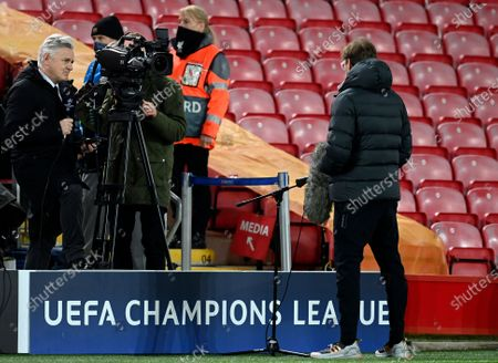 Liverpool's manager Jurgen Klopp, right, is interviewed by BT Sports Des Kelly before the Champions League group D soccer match between Liverpool and Ajax at Anfield stadium in Liverpool, England