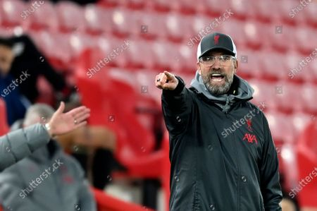 Liverpool's manager Jurgen Klopp gives instructions to his players during the Champions League group D soccer match between Liverpool and Ajax at Anfield stadium in Liverpool, England