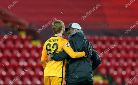 Liverpool's manager Jurgen Klopp, right, celebrates with Liverpool's goalkeeper Caoimhin Kelleher at the end of the Champions League group D soccer match between Liverpool and Ajax at Anfield stadium in Liverpool, England