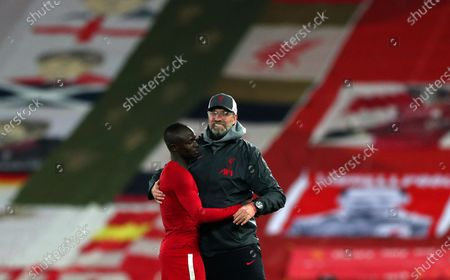Liverpool's manager Jurgen Klopp, right, celebrates with Liverpool's Sadio Mane at the end of the Champions League group D soccer match between Liverpool and Ajax at Anfield stadium in Liverpool, England