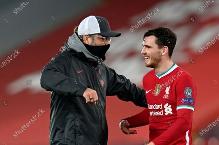 Stock Image of Liverpool's manager Jurgen Klopp, left, celebrates with Liverpool's Andrew Robertson at the end of the Champions League group D soccer match between Liverpool and Ajax at Anfield stadium in Liverpool, England