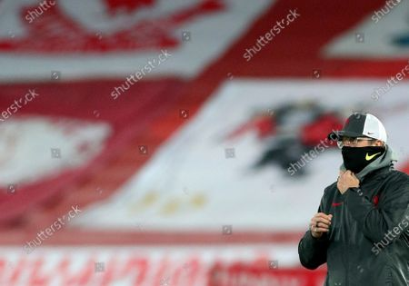 Liverpool's manager Jurgen Klopp looks on during warm up before the Champions League group D soccer match between Liverpool and Ajax at Anfield stadium in Liverpool, England