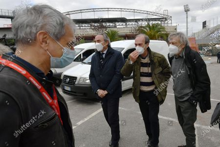Stock Picture of Gino Strada visits the Army field hospital mounted in Crotone to deal with the Covid-19 emergency in the province.