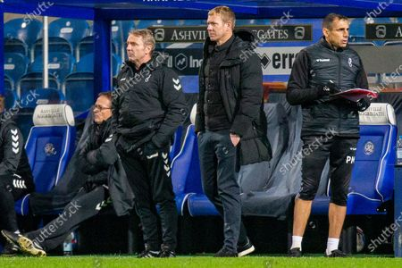 Bristol City assistant head coach Paul Simpson, Bristol City head coach Dean Holden, Bristol City goalkeeping coach Pat Mountain during the EFL Sky Bet Championship match between Queens Park Rangers and Bristol City at the Kiyan Prince Foundation Stadium, London