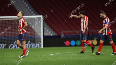Atletico Madrid players (L-R) Marcos Llorente, Stefan Savic, and Koke react after the UEFA Champions League group A soccer match between Atletico Madrid and Bayern Munich in Madrid, Spain, 01 December 2020.