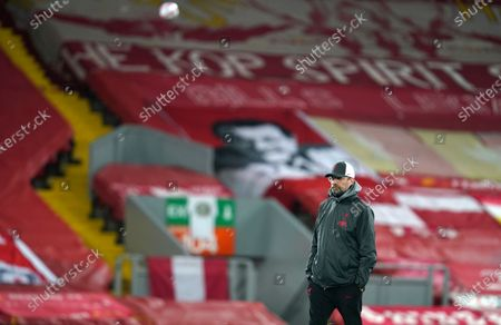 Stock Picture of Liverpool's manager Jurgen Klopp walks win the pitch prior the starts of the Champions League group D soccer match between Liverpool and Ajax at Anfield stadium in Liverpool, England