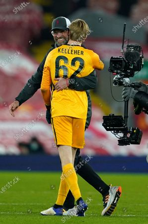Stock Photo of Liverpool's manager Jurgen Klopp, left, hugs Liverpool's goalkeeper Caoimhin Kelleher after the Champions League group D soccer match between Liverpool and Ajax at Anfield stadium in Liverpool, England