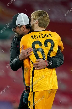 Liverpool's manager Jurgen Klopp, left, hugs Liverpool's goalkeeper Caoimhin Kelleher after the Champions League group D soccer match between Liverpool and Ajax at Anfield stadium in Liverpool, England