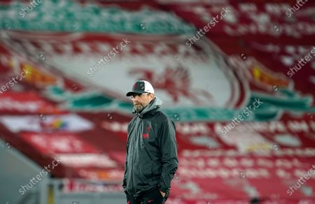 Liverpool's manager Jurgen Klopp walks win the pitch prior the starts of the Champions League group D soccer match between Liverpool and Ajax at Anfield stadium in Liverpool, England