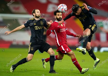 Ajax's Edson Alvarez, right, and Ajax's Daley Blind, left, challenge Liverpool's Mohamed Salah during the Champions League group D soccer match between Liverpool and Ajax at Anfield stadium in Liverpool, England