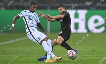 Inter's Ashley Young (L) in action against Moenchengladbach's Stefan Lainer (R) during the UEFA Champions League group B soccer match between Borussia Moenchengladbach and Inter Milan in Moenchengladbach, Germany, 01 December 2020.