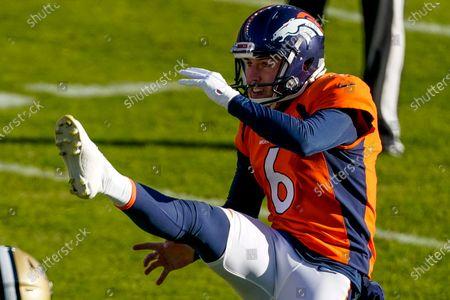 Denver Broncos punter Sam Martin punts against the New Orleans Saints during an NFL football game, in Denver