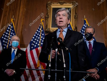 Sen. Roy Blunt(R-MO), foreground, talks to reporters as he, Senate Majority Leader Mitch McConnell(R-KY), left, and other Republican leaders including Sen. John Thune(R-SD), right, hold a press conference in the Mansfield Room at the US Capitol in Washington, DC, USA, 01 December 2020. The Senate GOP leaders were asked about the chances of Congress passing another coronavirus relief bill along with must-pass government funding legislation.