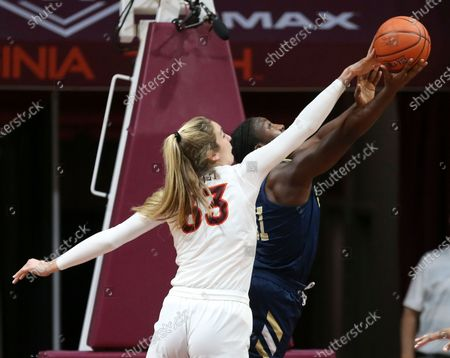 Virginia Tech's Elizabeth Kitley (33) of blocks a shot by George Washington's Essence Brown during the first half of an NCAA college basketball game in Blacksburg, Va