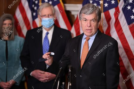 United States Senator Roy Blunt (Republican of Missouri), right, speaks during a news conference with US Senator Joni Ernst (Republican of Iowa), left, and US Senate Majority Leader Mitch McConnell (Republican of Kentucky), center, in the Mansfield Room at the U.S. Capitol in Washington, DC. The Senate GOP leaders were asked about the chances of Congress passing another coronavirus relief bill along with must-pass government funding legislation.