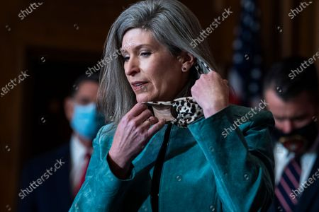 Stock Image of United States Senator Joni Ernst (Republican of Iowa) removes her mask prior to speaking with reporters following the weekly US Senate Republican Conference meeting in the Mansfield Room of the US Capitol in Washington, DC.