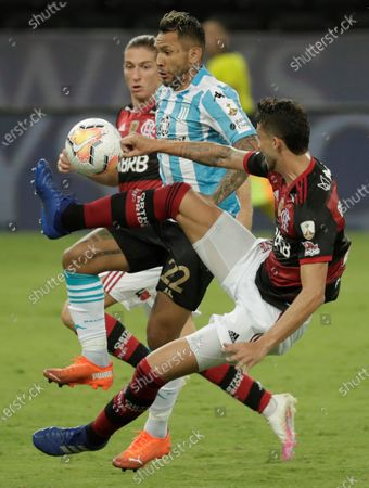 Flamengo's Filipe Luis (L) and Gustavo Henrique (R) in action against Racing's Walter Montoya (C) during the Copa Libertadores Round 16 match between Flamengo of Brazil and Argentinian Racing Club in Rio de Janeiro, Brazil, 01 December 2020.