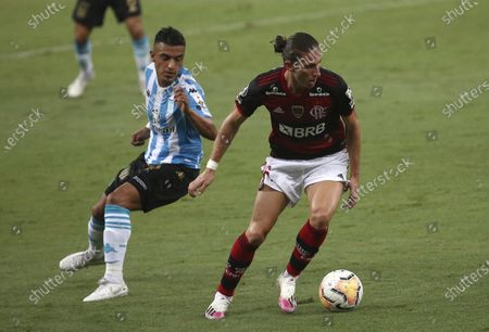 Filipe Luis of Brazil's Flamengo, right, and Leonel Miranda of Argentina's Racing Club battle for the ball during a Copa Libertadores round of 16 second leg soccer match at the Maracana stadium in Rio de Janeiro, Brazil, Tuesday, Dec.1, 2020