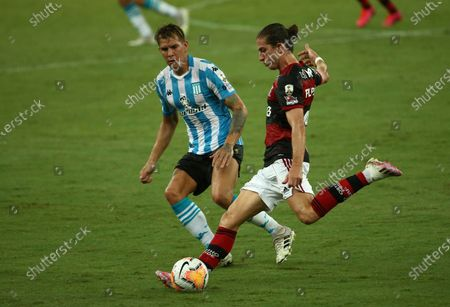 Filipe Luis of Brazil's Flamengo, right, and Gaston Reniero of Argentina's Racing Club battle for the ball during a Copa Libertadores round of 16 second leg soccer match at the Maracana stadium in Rio de Janeiro, Brazil, Tuesday, Dec.1, 2020