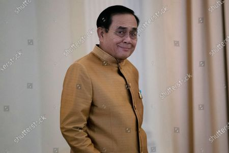 Thailand's Prime Minister Prayuth Chan-ocha arrives to speak to the media during a press conference at Government House in Bangkok, Thailand, . Thailand's highest court is set to rule Wednesday, Dec. 2, 2020 on whether Prayuth has breached ethics clauses in the country's constitution and should be ousted from his position