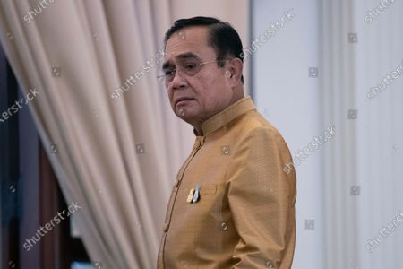 Thailand's Prime Minister Prayuth Chan-ocha leaves after a press conference at Government House in Bangkok, Thailand, . Thailand's highest court is set to rule Wednesday, Dec. 2, 2020 on whether Prayuth has breached ethics clauses in the country's constitution and should be ousted from his position