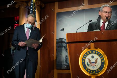 United States Senate Minority Leader Chuck Schumer (Democrat of New York), left, listens while US Senator Bob Menendez (Democrat of New Jersey) offers remarks during a press conference at the US Capitol in Washington, DC.,.