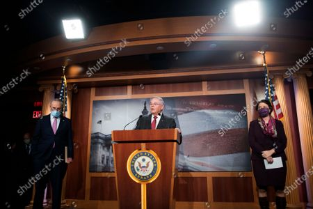 United States Senator Bob Menendez (Democrat of New Jersey) offers remarks while joined by US Senate Minority Leader Chuck Schumer (Democrat of New York) left, and US Senator Amy Klobuchar (Democrat of Minnesota), right, during a press conference at the US Capitol in Washington, DC.,.