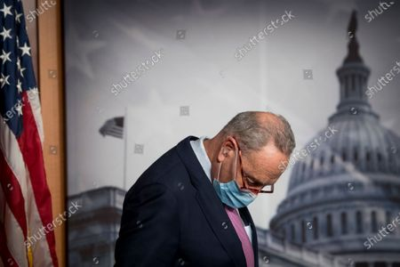 United States Senate Minority Leader Chuck Schumer (Democrat of New York) listens while United States Senator Bob Menendez (Democrat of New Jersey) offers remarks during a press conference at the US Capitol in Washington, DC.,.