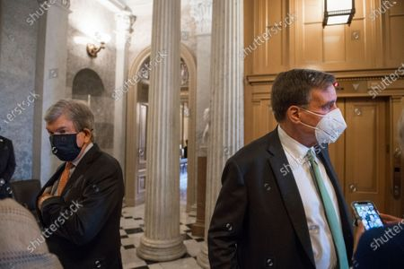 United States Senator Roy Blunt (Republican of Missouri), left, and US Senator Mark Warner (Democrat of Virginia), right, talk with reporters as they arrive at the Senate chamber for a vote at the US Capitol in Washington, DC.,.