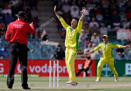 Australia's Ashton Agar, center, appeals successfully for LBW to dismiss India's K.L. Rahul during their one day international cricket match at Manuka Oval in Canberra, Australia