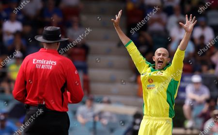 Australia's Ashton Agar, right, appeals to the umpire and is granted a LBW decision on India's Shubman Gill during their one day international cricket match at Manuka Oval in Canberra, Australia