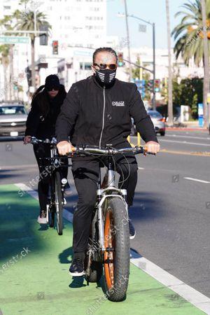 Arnold Schwarzenegger and Christina Schwarzenegger seen on a bike ride