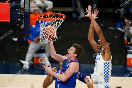 Kansas' Christian Braun (2) puts up a shot against Kentucky's Isaiah Jackson during the first half of an NCAA college basketball game, in Indianapolis