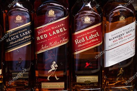 Stock Image of Johnnie Walker whiskey bottles seen at the grocery store.