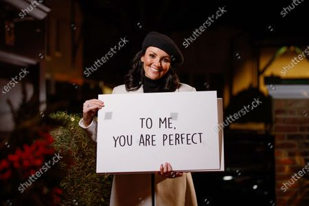 Martine McCutcheon surprises a couple at home, as she delivers a Love Actually inspired doorstep greeting to celebrate the launch of NOW TV's Christmas movie season.
