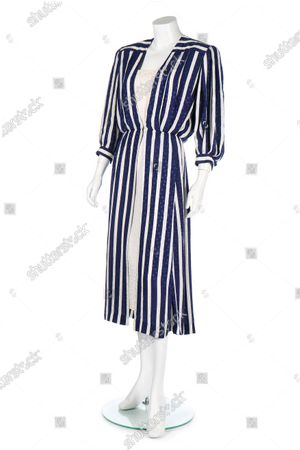 The navy and white striped silk dress Diana had made for the Royal tour of the Gulf States with Prince Charles in 1986.   Sketches by Elizabeth Emanuel showing some of Princess Diana's most iconic outfits have emerged for sale.  The seven drawings include Diana's fairytale royal wedding gown and the controversial plunging evening gown that earned her the nickname 'Daring Di' with the world's media.