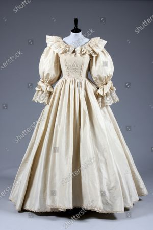 A replica of Princess Diana's fairytale royal wedding gown created for Madame Tussauds.   Sketches by Elizabeth Emanuel showing some of Princess Diana's most iconic outfits have emerged for sale.  The seven drawings include Diana's fairytale royal wedding gown and the controversial plunging evening gown that earned her the nickname 'Daring Di' with the world's media.