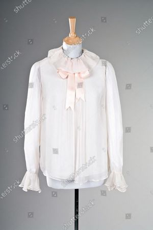 Stock Photo of The pink chiffon blouse that first attracted Diana to the Emanuels.   Sketches by Elizabeth Emanuel showing some of Princess Diana's most iconic outfits have emerged for sale.  The seven drawings include Diana's fairytale royal wedding gown and the controversial plunging evening gown that earned her the nickname 'Daring Di' with the world's media.
