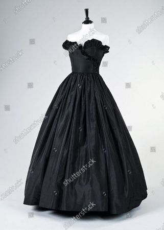 Stock Picture of The evening gown that earned Princess Diana the nickname 'Daring Di' with the world's media.   Sketches by Elizabeth Emanuel showing some of Princess Diana's most iconic outfits have emerged for sale.  The seven drawings include Diana's fairytale royal wedding gown and the controversial plunging evening gown that earned her the nickname 'Daring Di' with the world's media.
